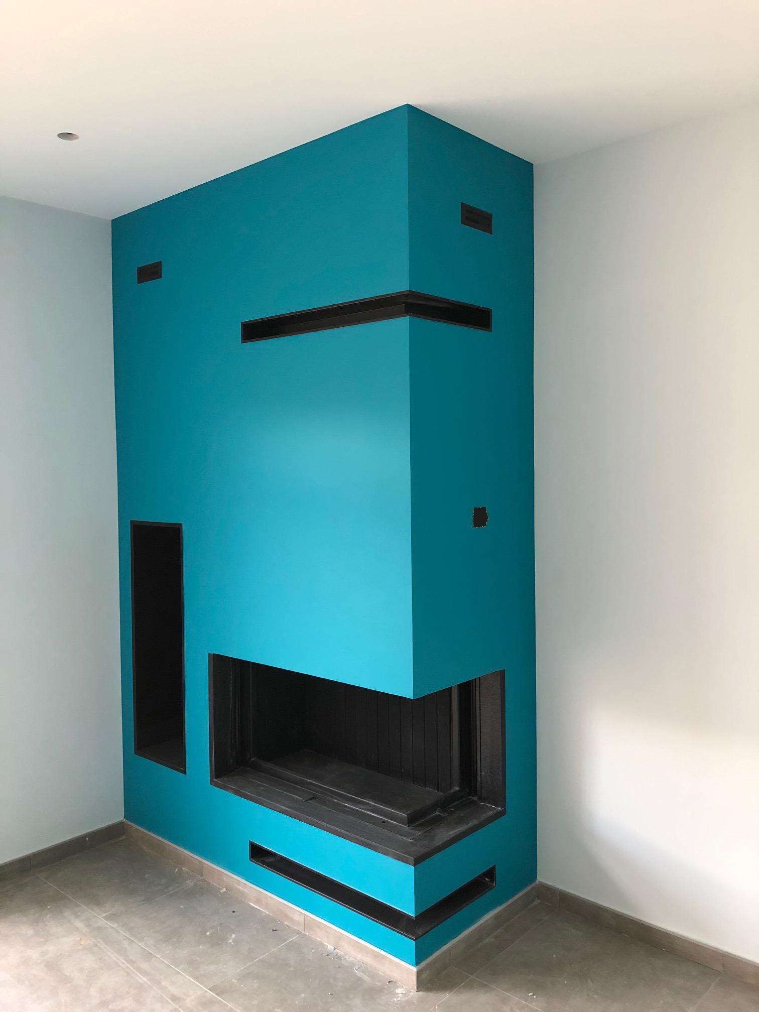Cheminée contemporaine avec cadre granit foyer en L Rüegg 720 Compact